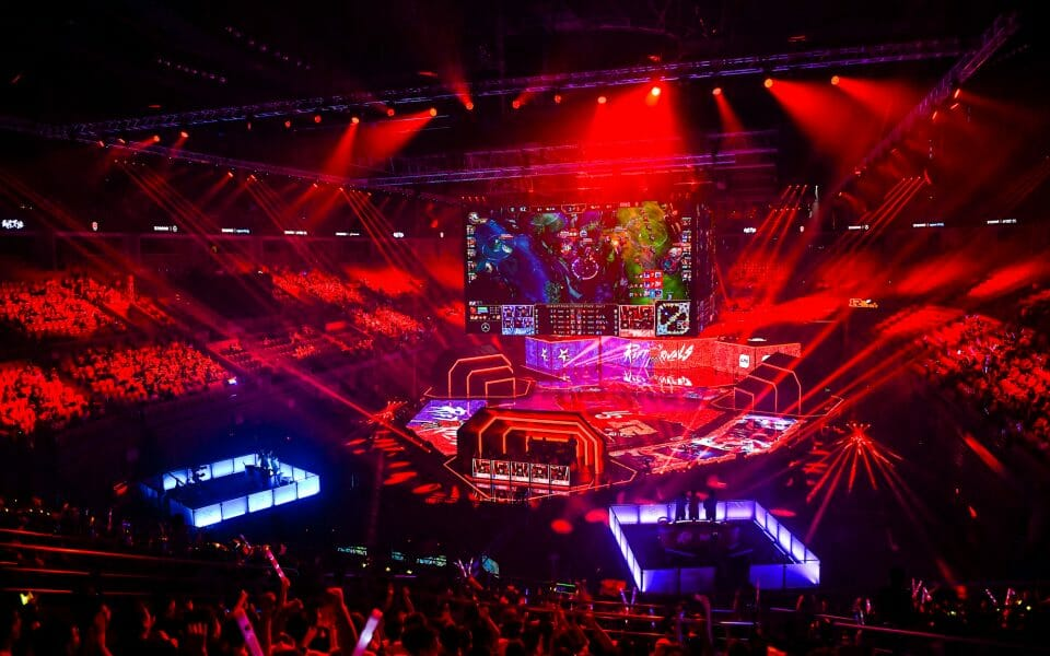 Competitive eSports players compete in a tournmant at the top of the League of Legends Ranking System