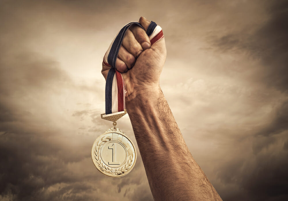 Winning League of Legends and Holding Up a First Place Medal