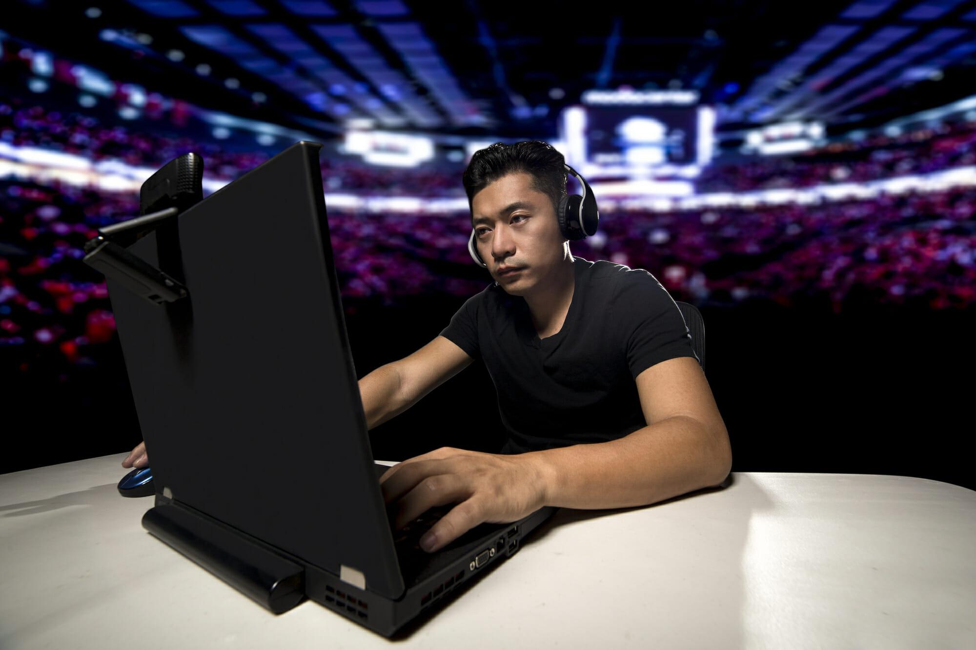 eSports Competitive Gamer in a Stadium Coaching LoL Team